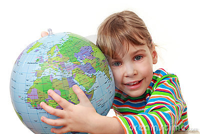 Little girl in shirt play with inflatable globe