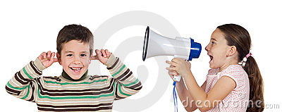 Little girl shouting through megaphone at a boy