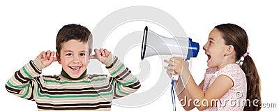 Little girl shouting through megaphone at a boy