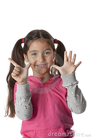 Little girl is showing 7 fingers