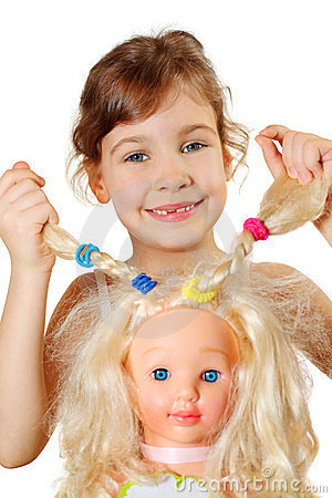 Little girl shows dolls braids