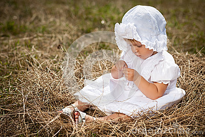 A little girl sits in the nest