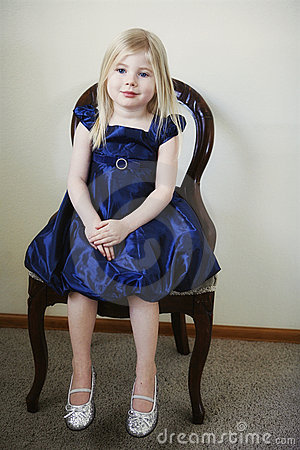Little girl sitting in chair