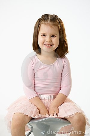 Little girl sitting on chair