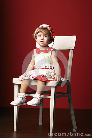 little girl sitting on chair royalty free stock images image 35721509. Black Bedroom Furniture Sets. Home Design Ideas