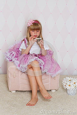 little girl is sitting on a chair stock photo image 44191254. Black Bedroom Furniture Sets. Home Design Ideas