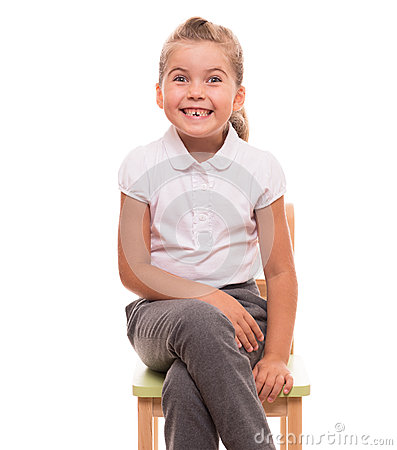 Little girl sitting on a chair and smiling