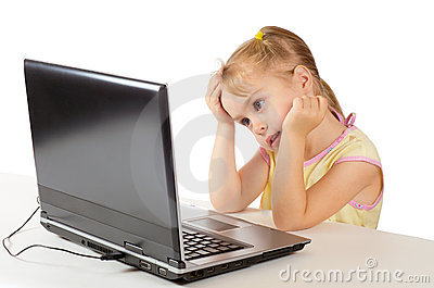 Little girl sitting at a computer