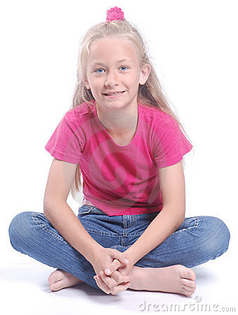Little girl sitting cross-legged Stock Photo