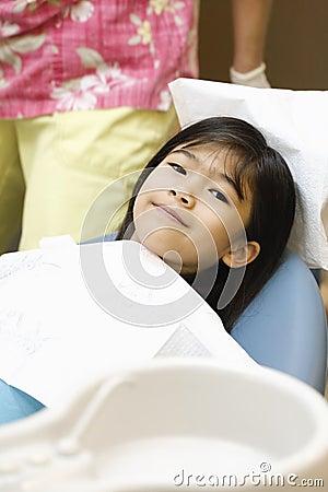 Little girl sitting in dentist s chair