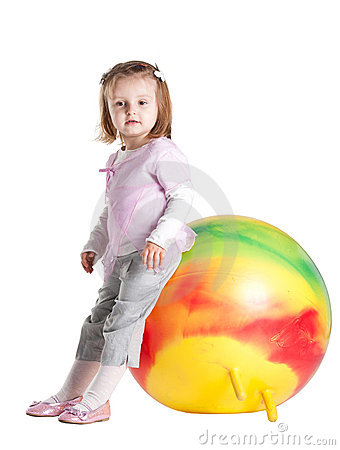 Little girl sitting on fitball