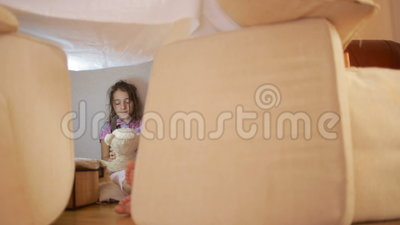 A Little Girl Is Sitting In A Makeshift House Of Pillows And A Blanket House Stock Footage - Video of fort, laying: 90368312->