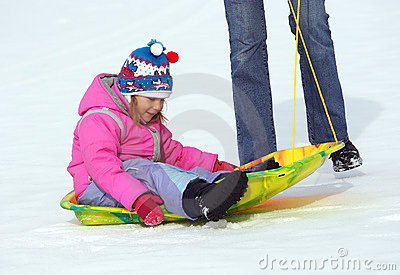 Little girl and sled