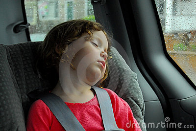 Little Girl Sleeping in Car Seat