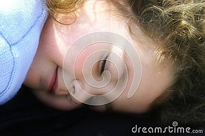 Little girl sleeping in the sun