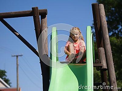 Little girl on a slide