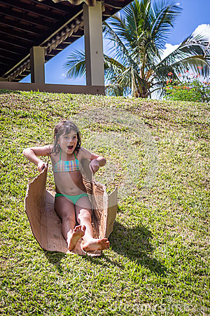 Free Little Girl Sliding On Grass Royalty Free Stock Photos - 55397168