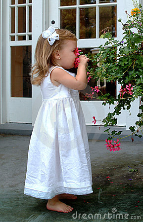 Little Girl Smelling Flower