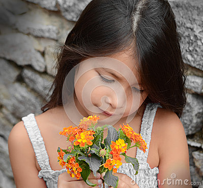 Free Little Girl Smelling Flowers Stock Image - 28465261