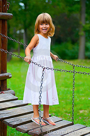 Free Little Girl Smiles While Standing On The Bridge Stock Image - 20598531