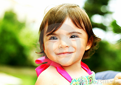 Little girl smiling, closeup portrait