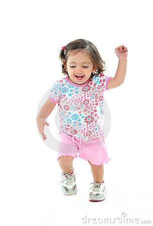 Little girl smiling and dancing