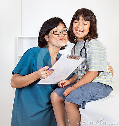 Little Girl Smiling with Friendly Doctor