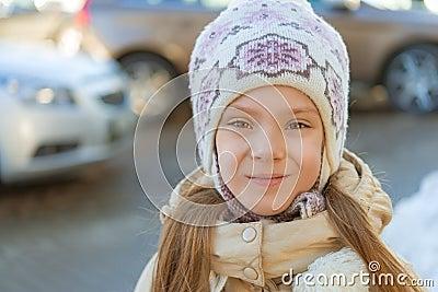 Little girl smiling in hat