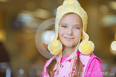 Little girl smiling in yellow hat