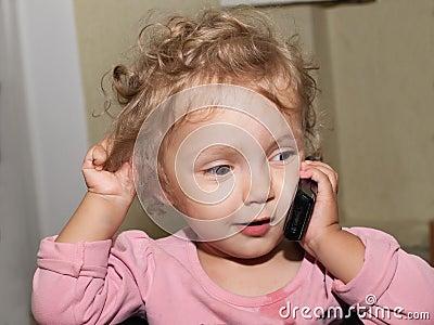 Little girl speaks by phone