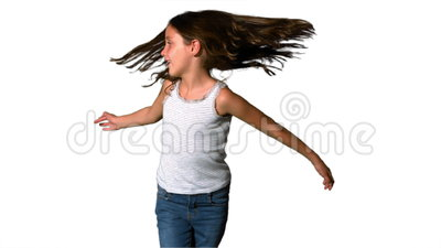 Little Girl Spinning Around On White Background Stock