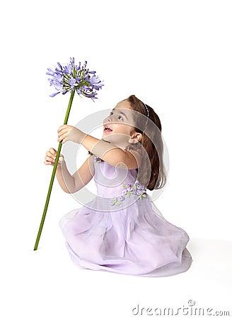Little girl spinning a flower
