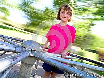 Little Girl on Spinning Merri-Go-Round