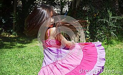 little girl spinning outside