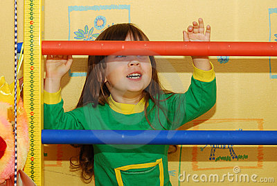 The little girl and a sports ladder