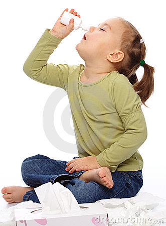 Little girl spraying her nose
