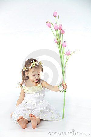 Little girl in spring flower dress
