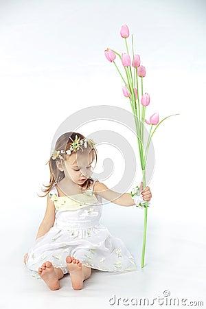 Little girl in spring flower dress