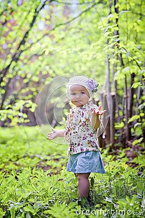 Little girl in spring forest
