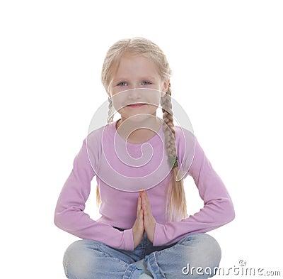 The little girl squatting crosslegged