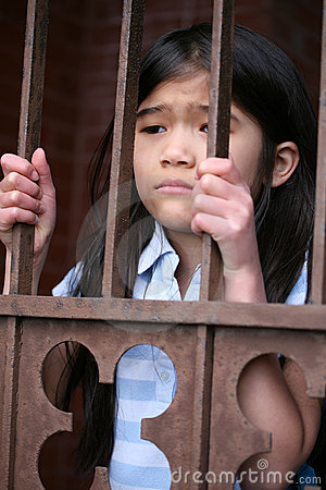 Little Girl Standing Behind Iron Bars Stock Photo - Image: 9634390
