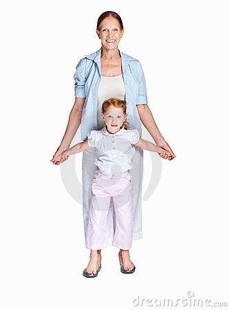 Little girl standing on her grandmother feet