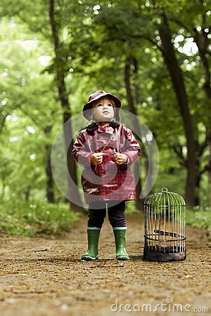 Free Little Girl Standing In Forest Looking For Her Lost Bird Royalty Free Stock Photography - 109286717