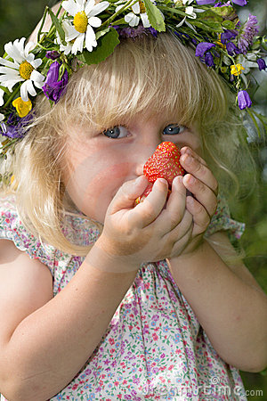 Little girl with strawberries in hands