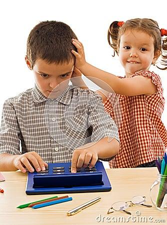 Little girl stroking the boy s head