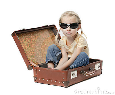Little girl in suitcase