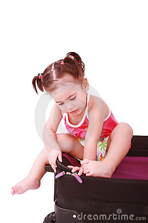 Little girl in a suitcase.