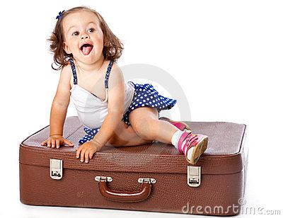 A little girl on the suitcase
