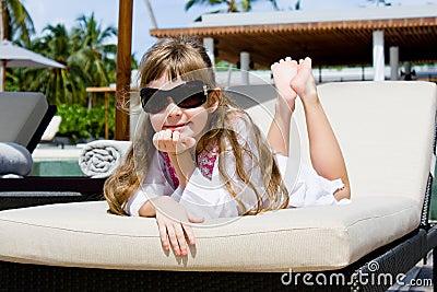 Little girl on sunbed