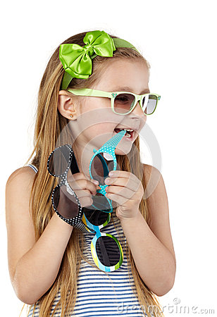 Little girl in sundress several sunglasses